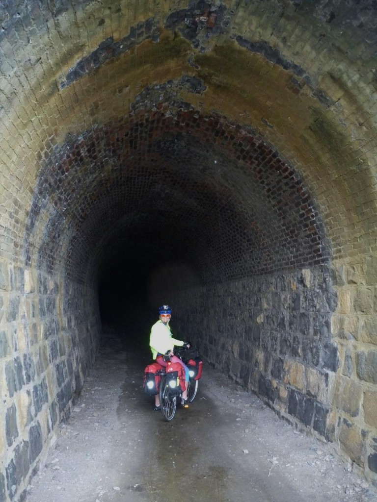 This train tunnel was built in 1890 with curved brick. Cutting it close for the train.