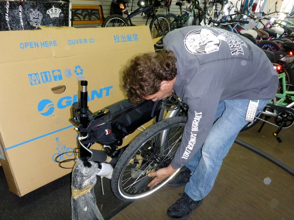 Matt figuring front wheel placement in box