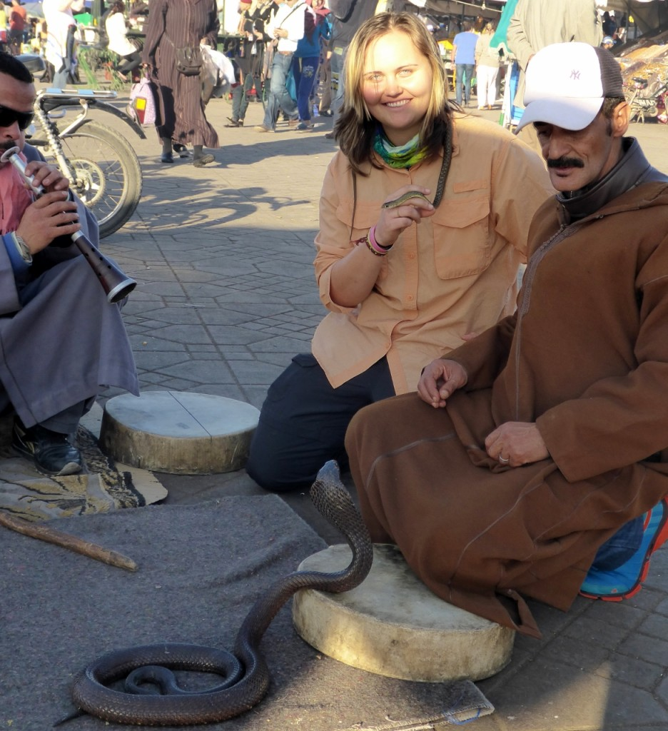 Jocelyn with a cobra snake charmer! The cobra struck at the guy on the right several times.