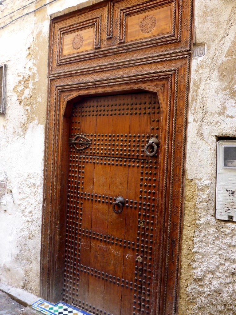 An upscale residential door in the Medina. There are two knockers. The top one is for visitors riding on mules.