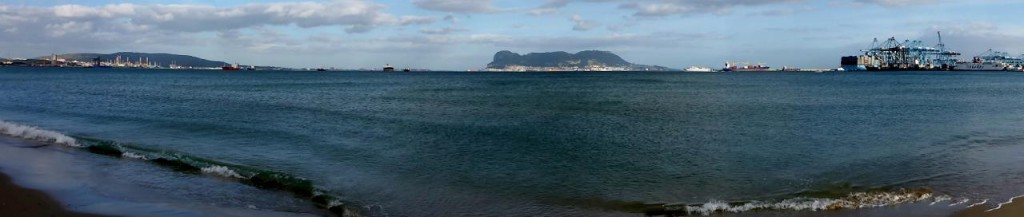 A nice walk along the beach. Gibraltar in the middle.