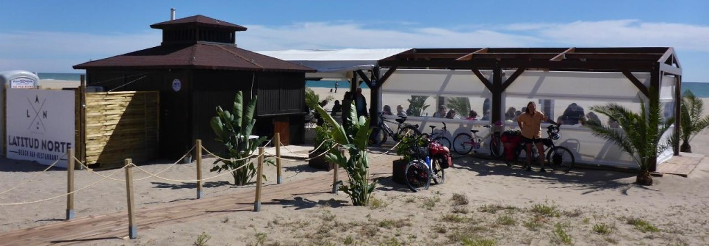 Our bikes found this really cool beach bar.
