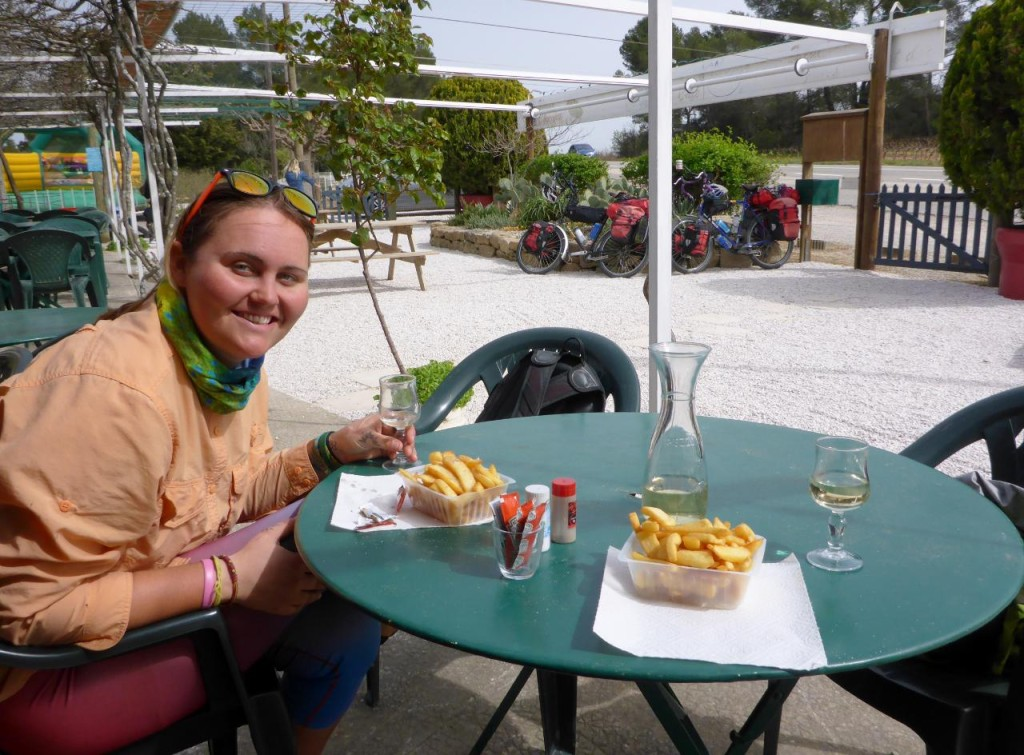 After battling hills and strong headwinds for 35 miles we pulled over for wine and chips to let our bikes rest.