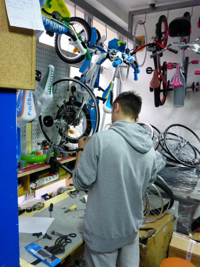 A bicycle repair shop in Podgorica building a new rear wheel for my bike.
