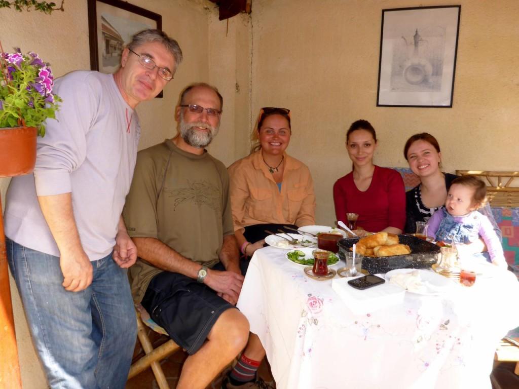 Around the breakfast table, Sead, Seida, Eldih's wife and daughter.