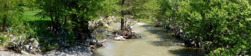 Trash in a river. Ecologically Serbia is in a sad state.