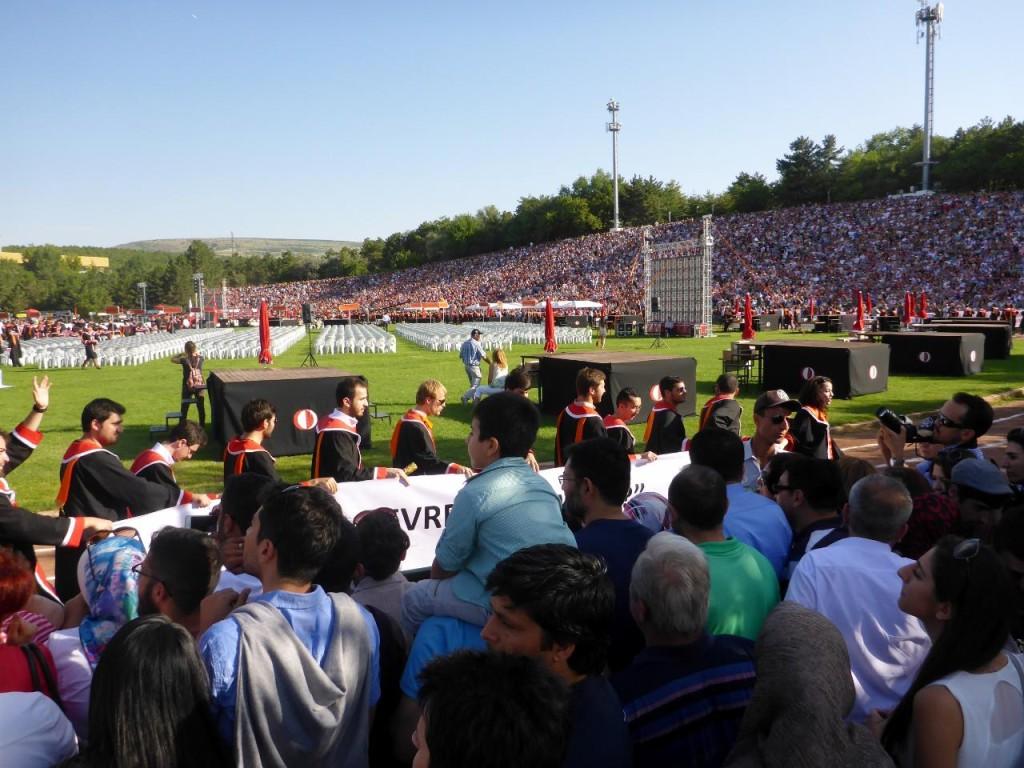 Graduates walking in.