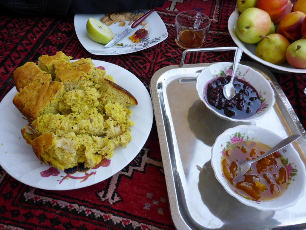 Delicious bread, homemade jams, nuts, and fruit along with chai.