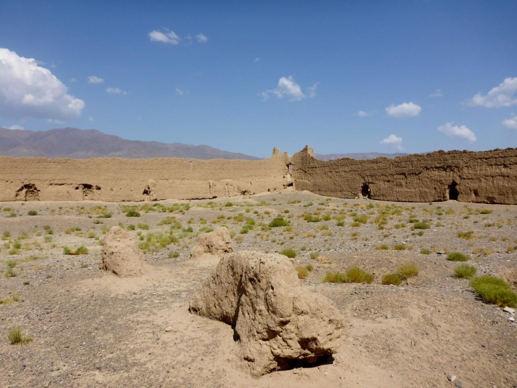 This was a stable for the camels and horses. The other mounds were various buildings. Built along the inside walls were elevated platforms containing rooms...the first motels.