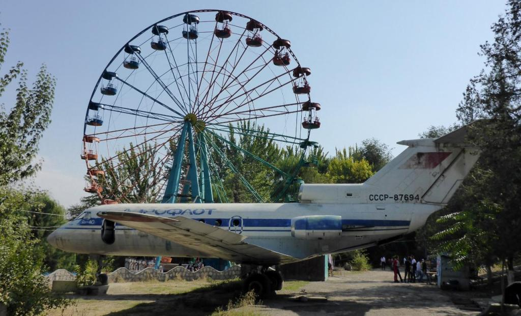 A park with a random Soviet Union plane. People got on and off the Ferris wheel while it was still moving. Kids just stood up during the entire ride.