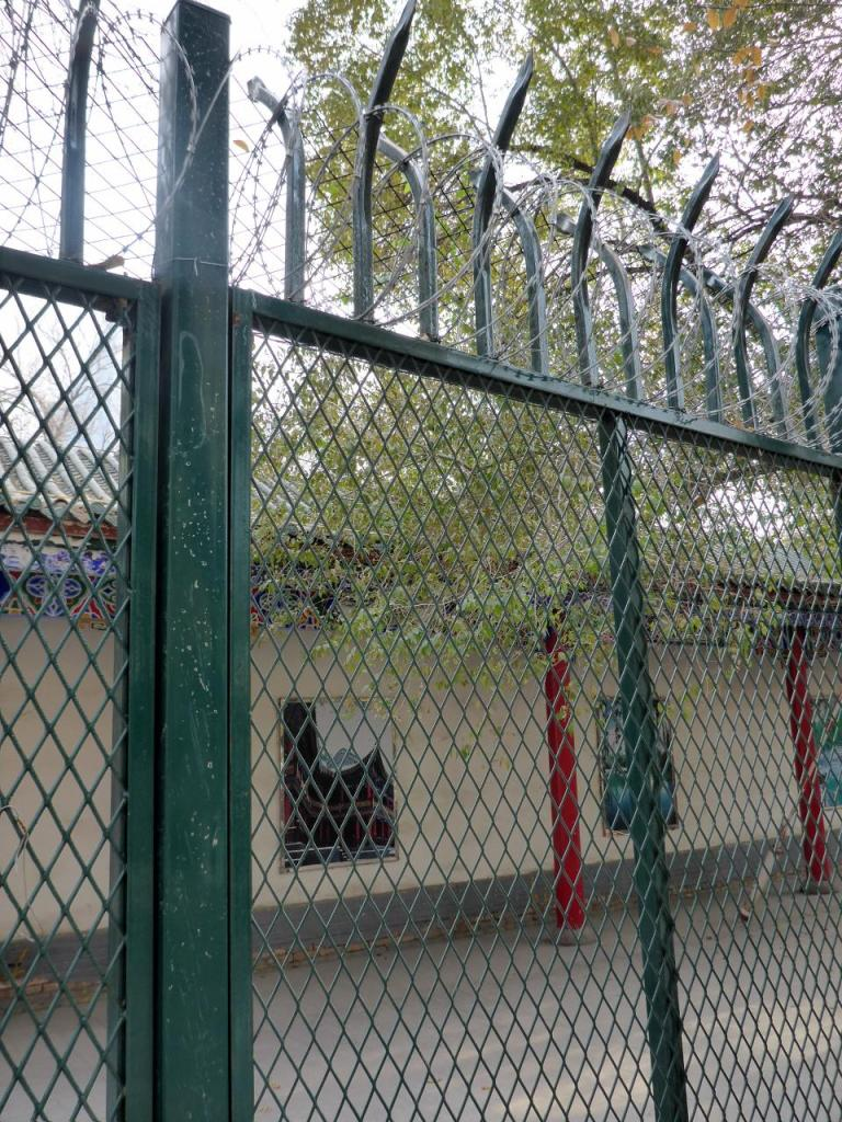 A fence around a Urumqi park. I don't understand the need for coiled razor wire.