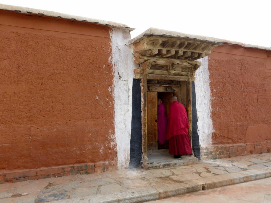 Several pictures follow showing the old Tibetan architecture and Buddhist symbols.