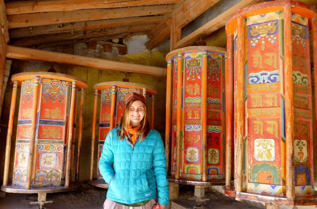 Walls of Tibetan prayer wheels surround the monastery. People pray by walking around the entire area and turning each wheel by hand.
