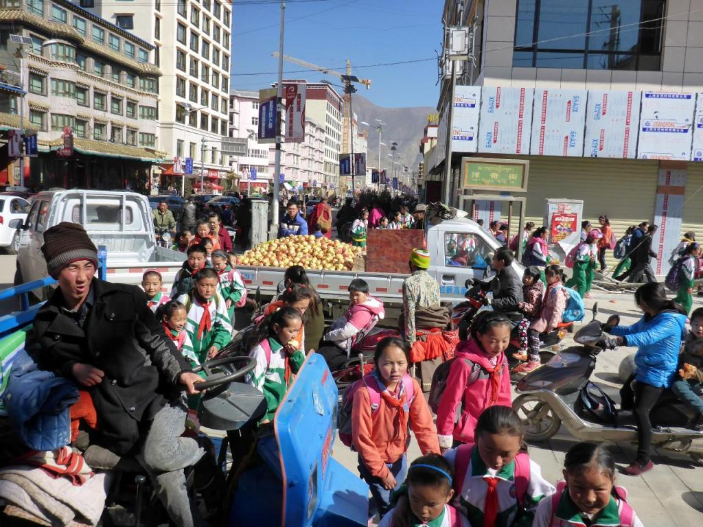 Noontime downtown Labrang. School just let out.