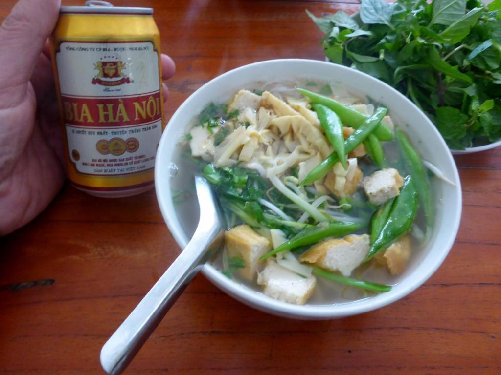 A very popular noodle dish in Vietnam called Pho along with a fine Vietnamese beer Hanoi.