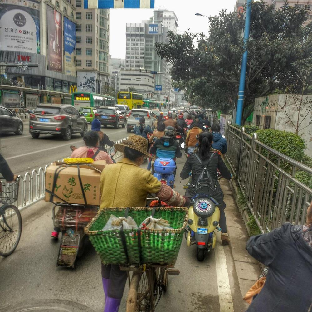 Cycling through Kunming.