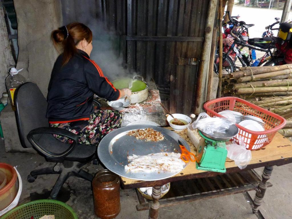 Our breakfast spot. She is making rice noodles that are mixed in a broth then topped with two fried eggs.