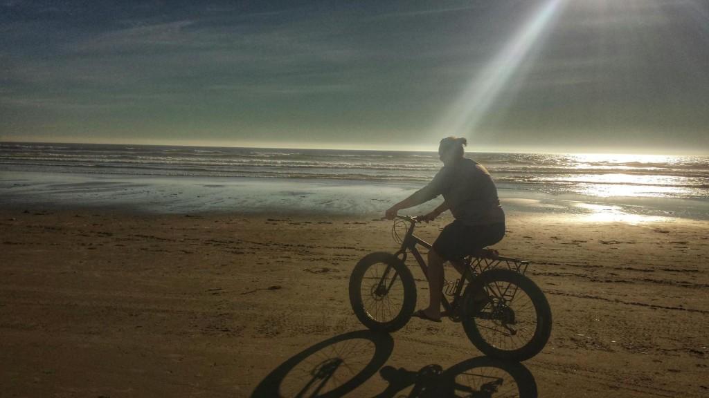 "Nicole riding a ""fatty"" on the beach."