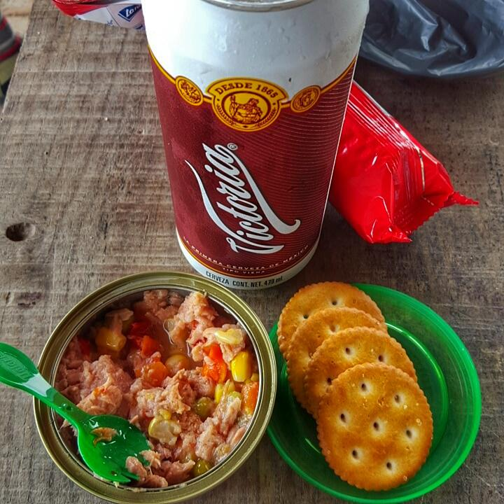 A delicious can of tuna and crackers for lunch.
