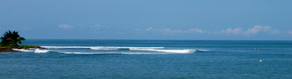 What a nice left surf break. Only two surfers out.