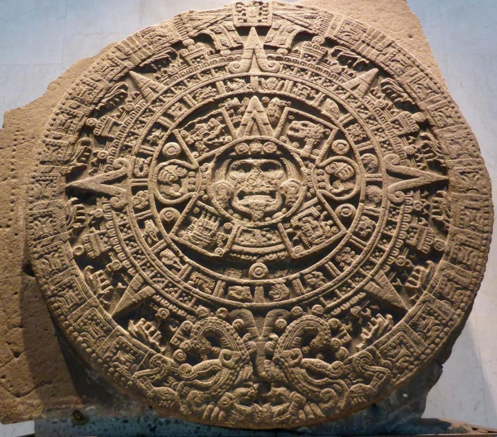 The sun god sacrificial altar found in 1790. Human sacrifices were made on this. On both side of the center head hearts are depicted being torn from bodies.