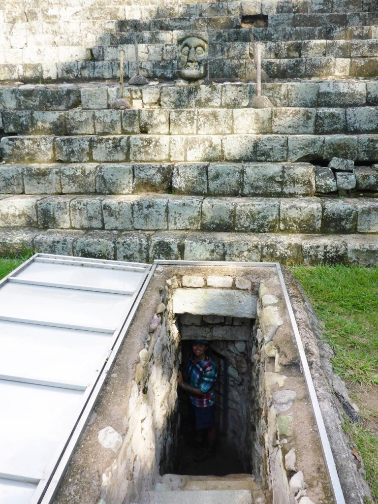 Entering one of the tunnels to explore the base of the temple. Skeleton head on top.