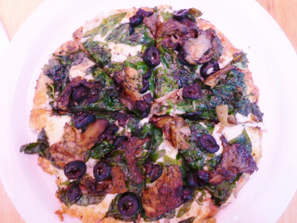 An excellent pizza with local mushrooms, spinach, and olives.