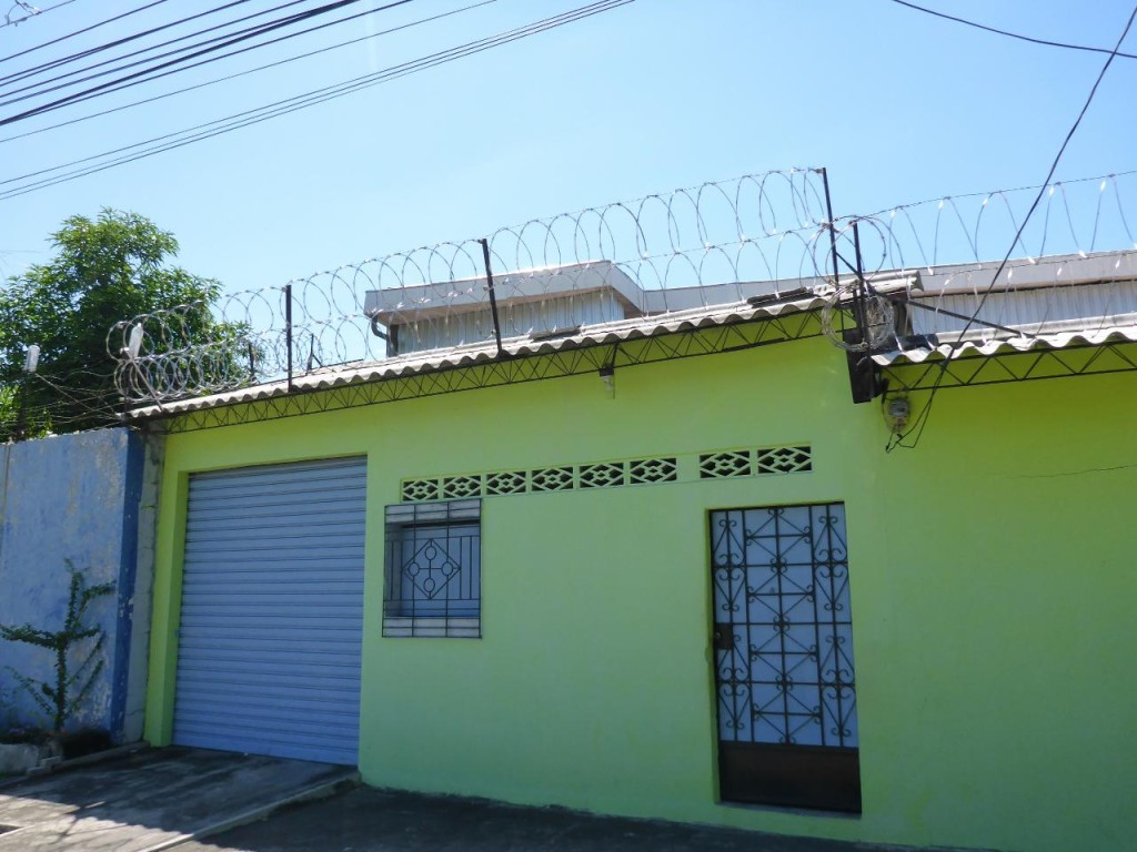 Double rolls of razor wire are very common here in both commercial and residential areas.