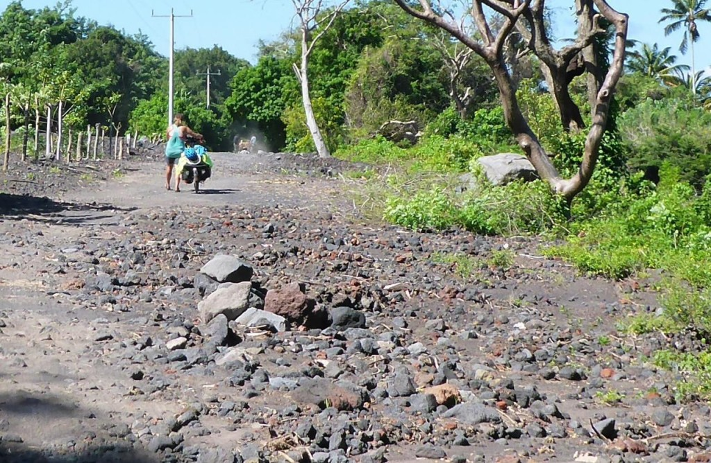 A recent lava flow that we crossed. Two mornings ago we inflated our tires. This morning we let air out for the rocky road.