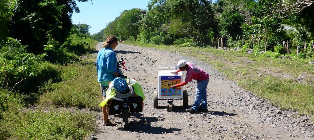 We spent a few hours on this road an along comes the ice cream guy who has been pushing his ice cream cart since Moyogalpa several miles away.