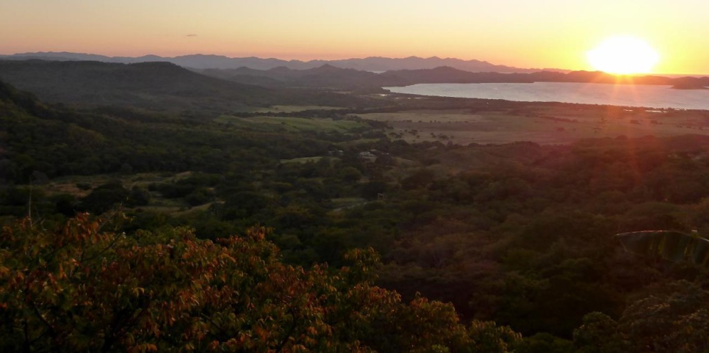 A beautiful sunset over Salinas Bay, Costa Rica. I was looking for brontosauruses to traverse through this valley as it looks like the movie set of Jurassic World.