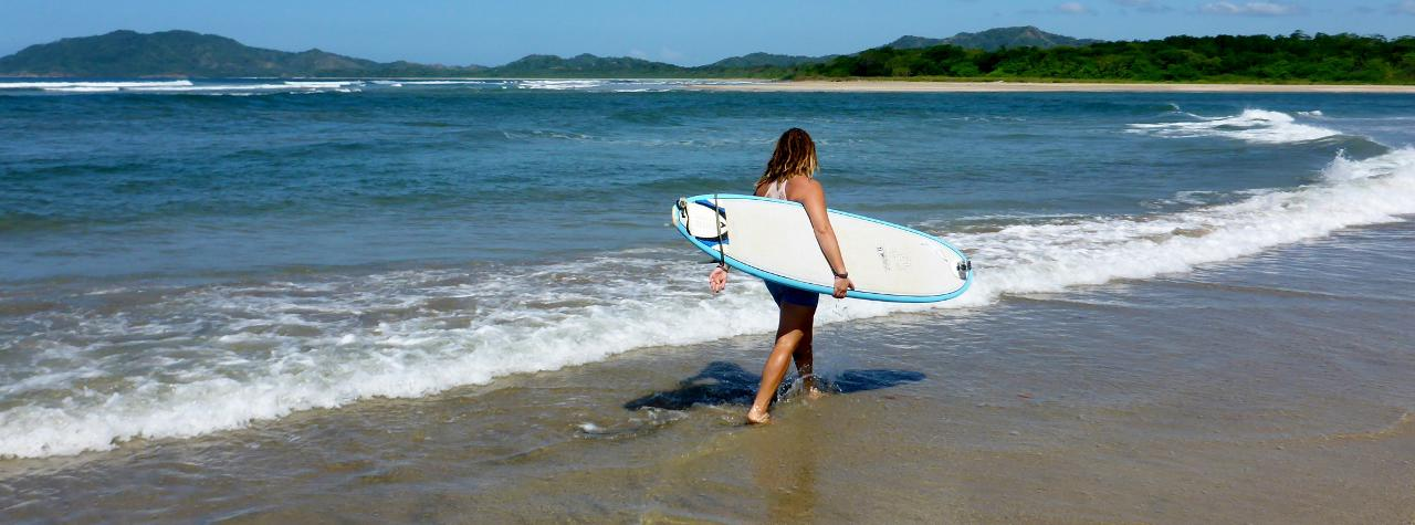 Surfing at Tamarindo Beach, Costa Rica.