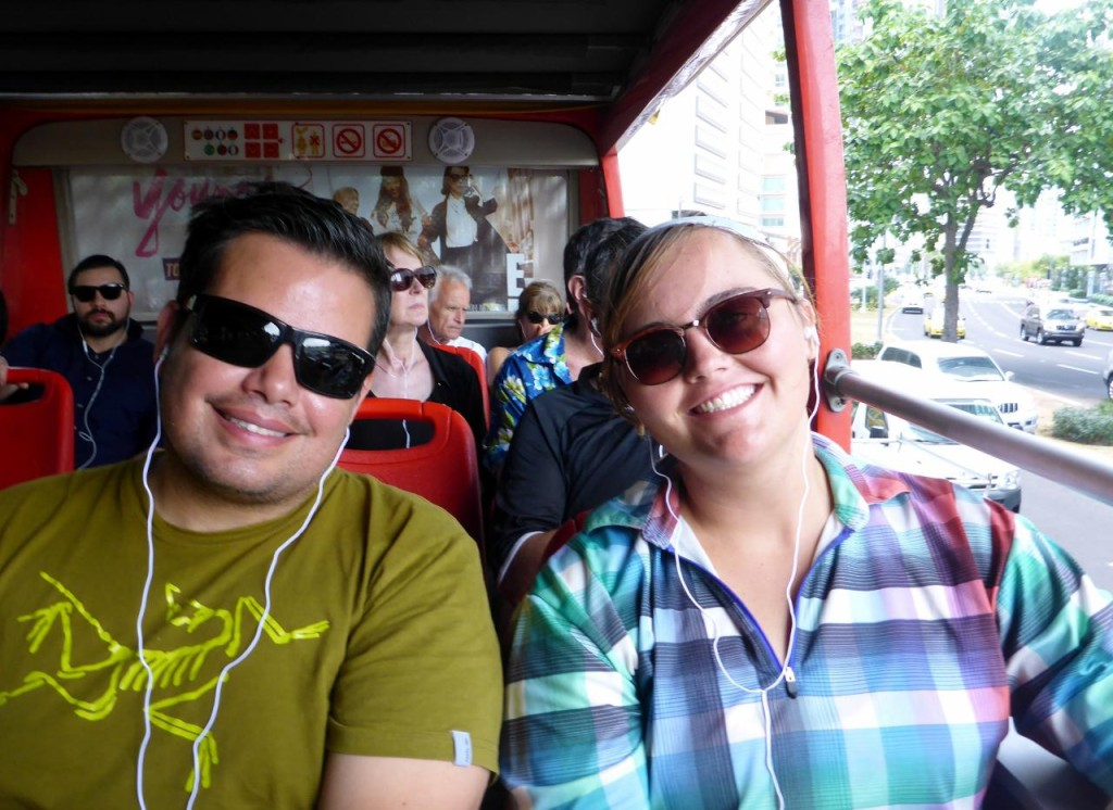 Jesse and Jocelyn touring the city on a double-decker bus.