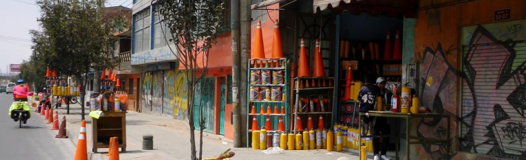 We have seen many different street vendors around the world. Here are fire extinguishers?