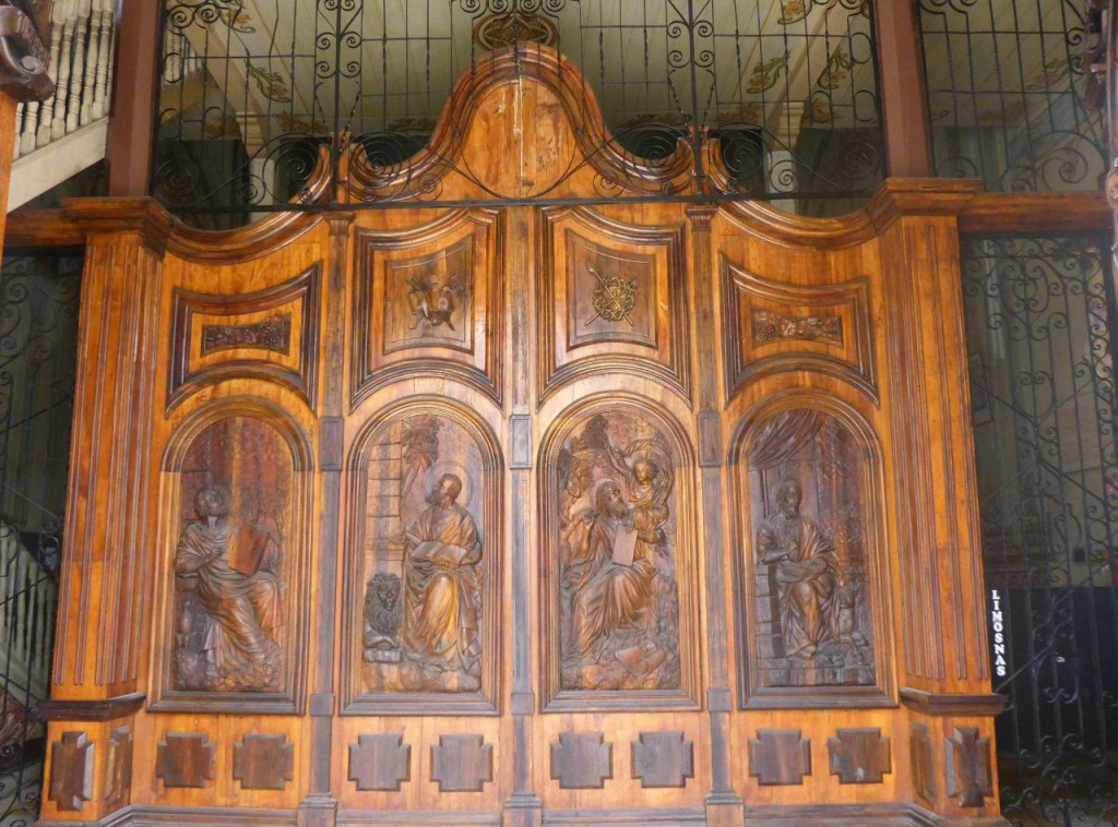 Most of the churches have heavy wood ornate doors.