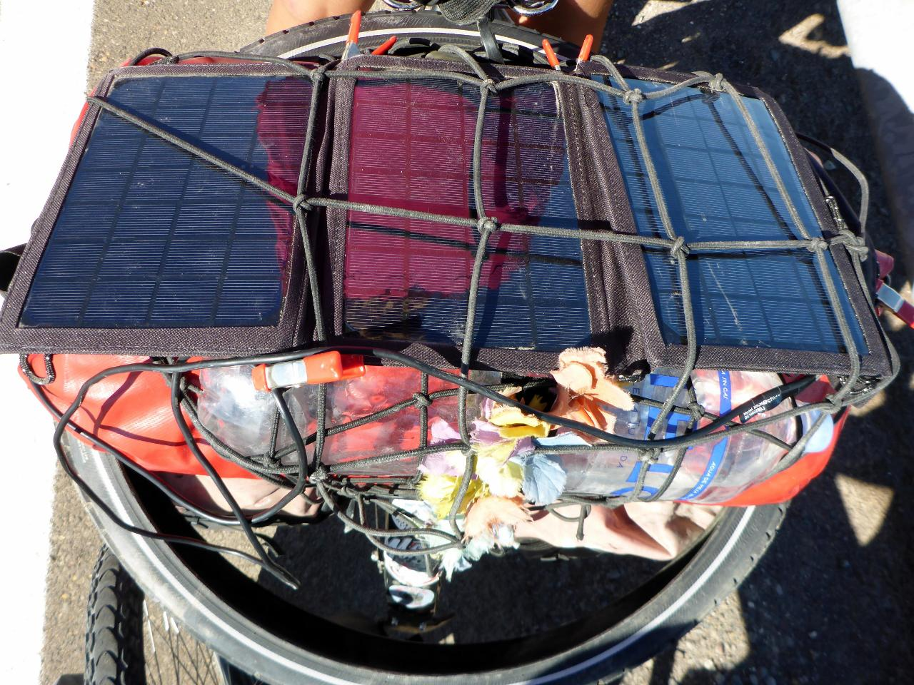 This solar panel charges Jocelyn's phone in less than two hours.