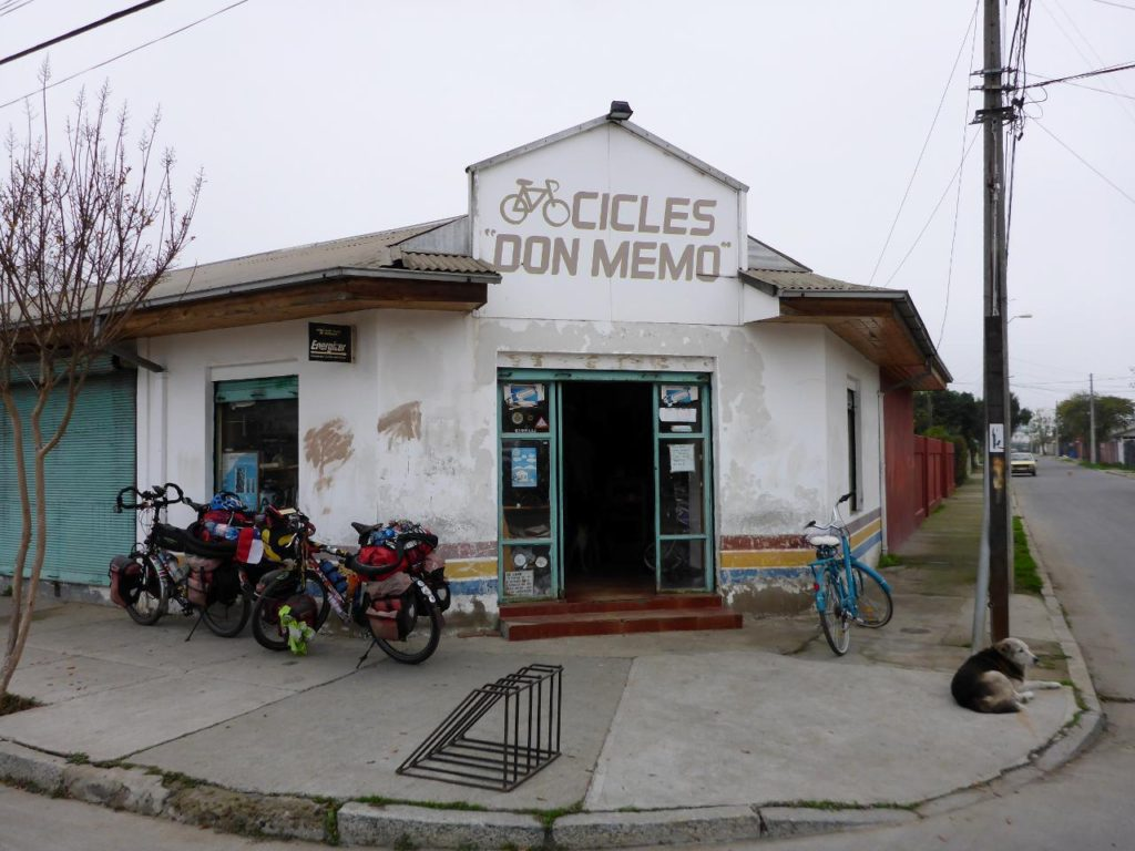 "We were down to one spare tube so I asked a guy riding a bike where a bike shops was. Another random English speaking Chilean had us follow him to this bike shop. 26""x2"" presta is very easy to find around the world."
