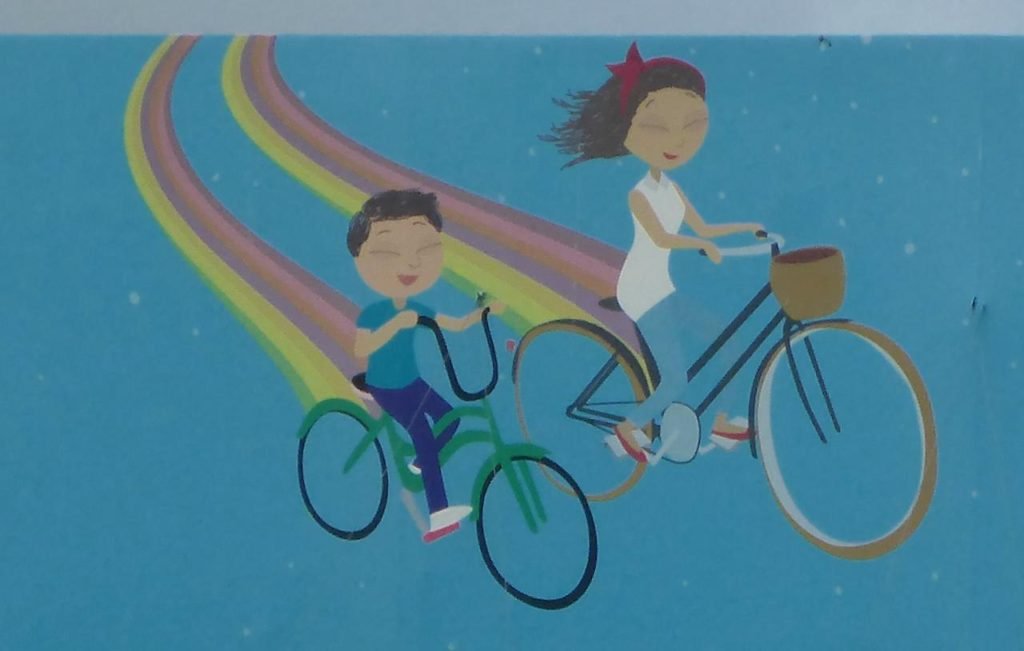 Picture from a billboard. Sometimes we feel like kids being able to ride our bikes all day everyday.