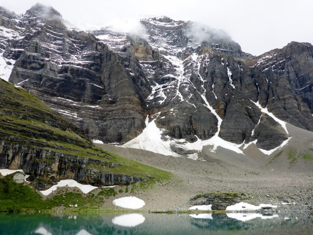 The destination over Sentinel Pass ( 8,600 f 2,621 m ) is Lake Moraine.